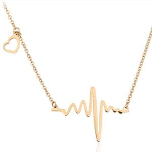 NWT. Gold Heartbeat Necklace